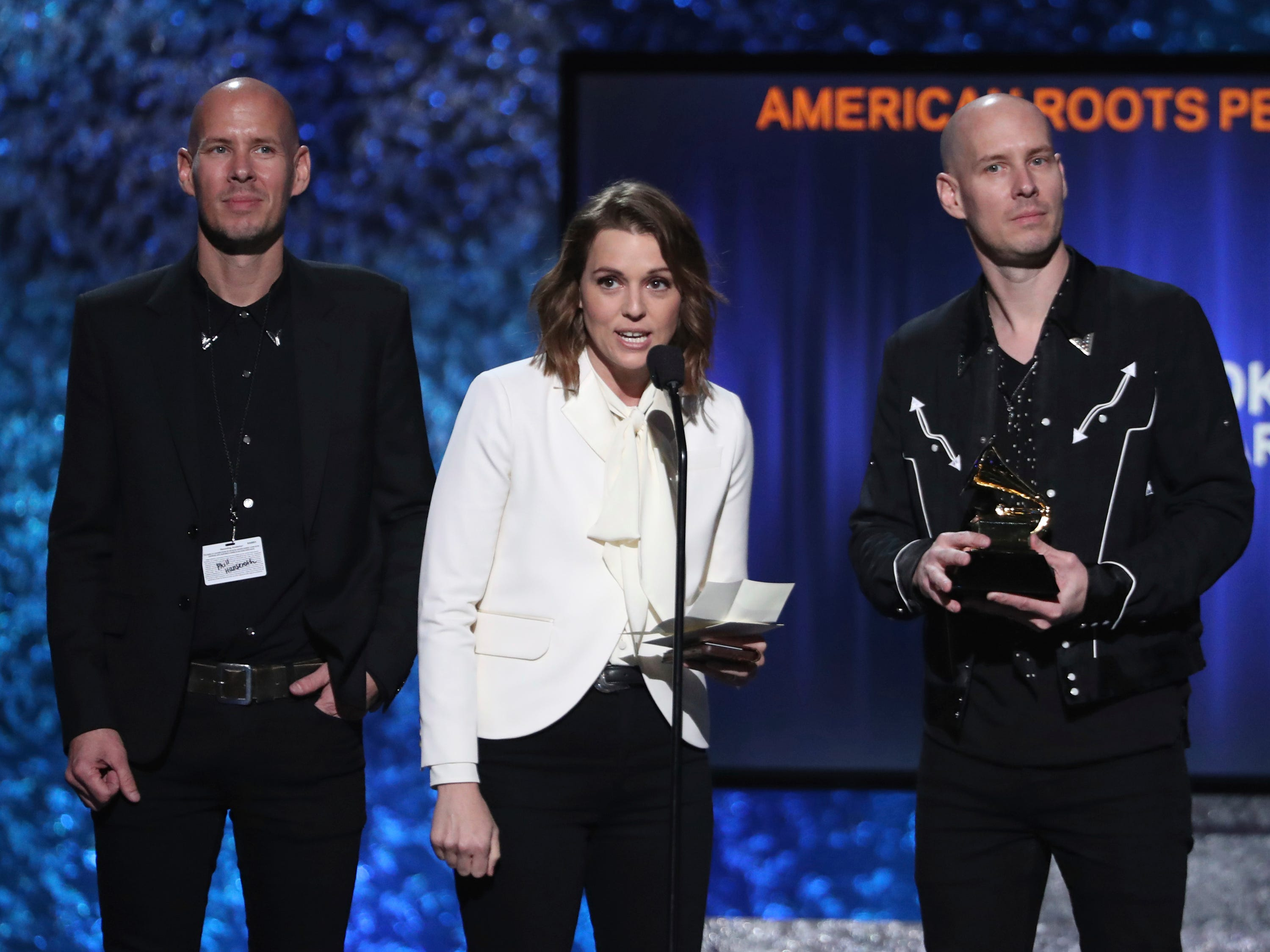 "Phil Hanseroth, from left, Brandi Carlile and Tim Hanseroth accept the award for best American roots performance for ""The Joke"" at the 61st annual Grammy Awards on Sunday, Feb. 10, 2019, in Los Angeles."
