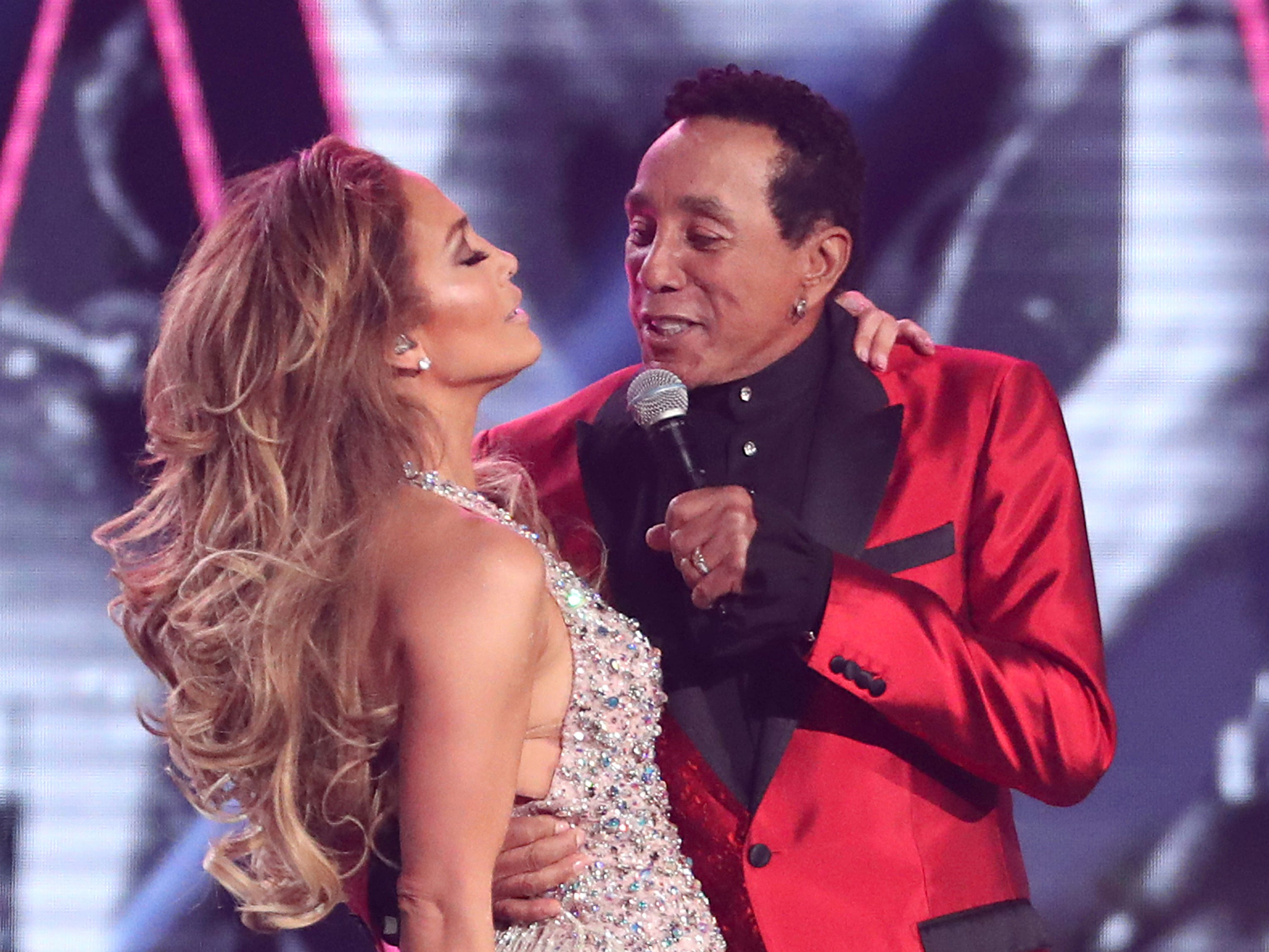 Jennifer Lopez, left, and Smokey Robinson perform a medley during a tribute to Motown's 60th anniversary at the 61st annual Grammy Awards on Sunday, Feb. 10, 2019, in Los Angeles.
