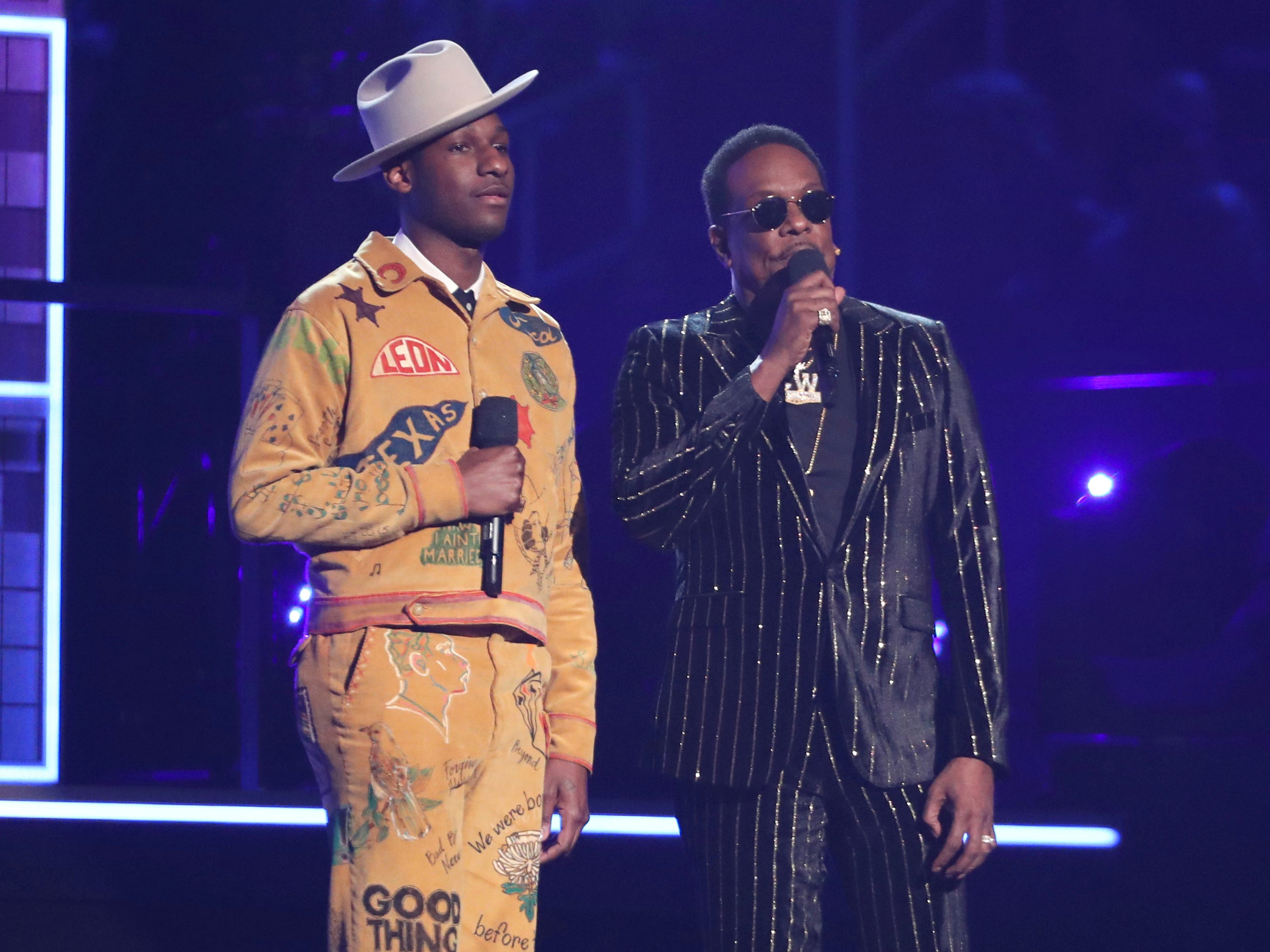 Leon Bridges, left, and Charlie Wilson introduce a performance at the 61st annual Grammy Awards on Sunday, Feb. 10, 2019, in Los Angeles.