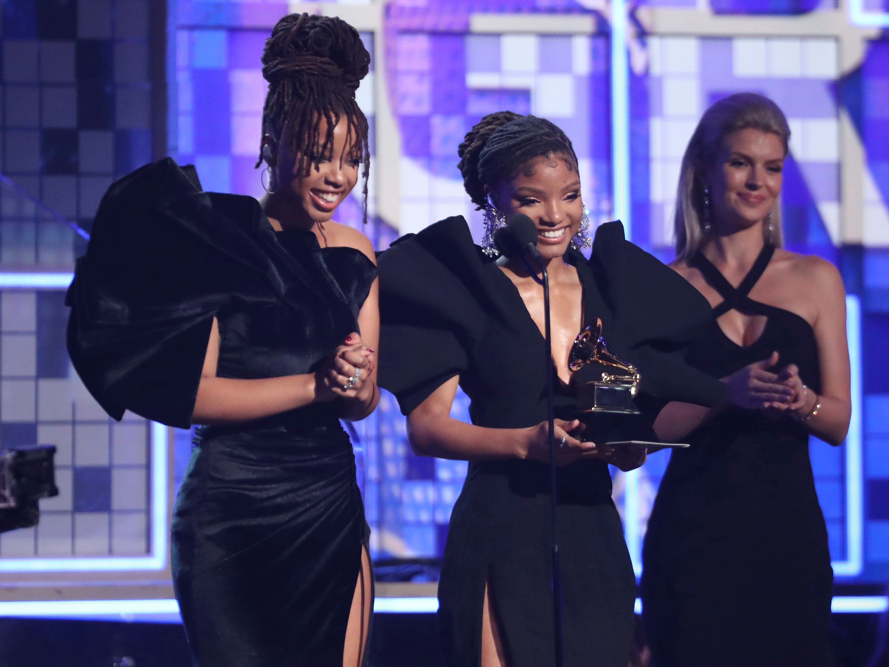 Halle Bailey, left, and Chloe Bailey, of Chloe X Halle, present the award for best rap album at the 61st annual Grammy Awards on Sunday, Feb. 10, 2019, in Los Angeles.