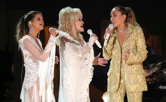 "Maren Morris, from left, Dolly Parton and Miley Cyrus perform ""After The Goldrush"" at the 61st annual Grammy Awards on Sunday, Feb. 10, 2019, in Los Angeles."