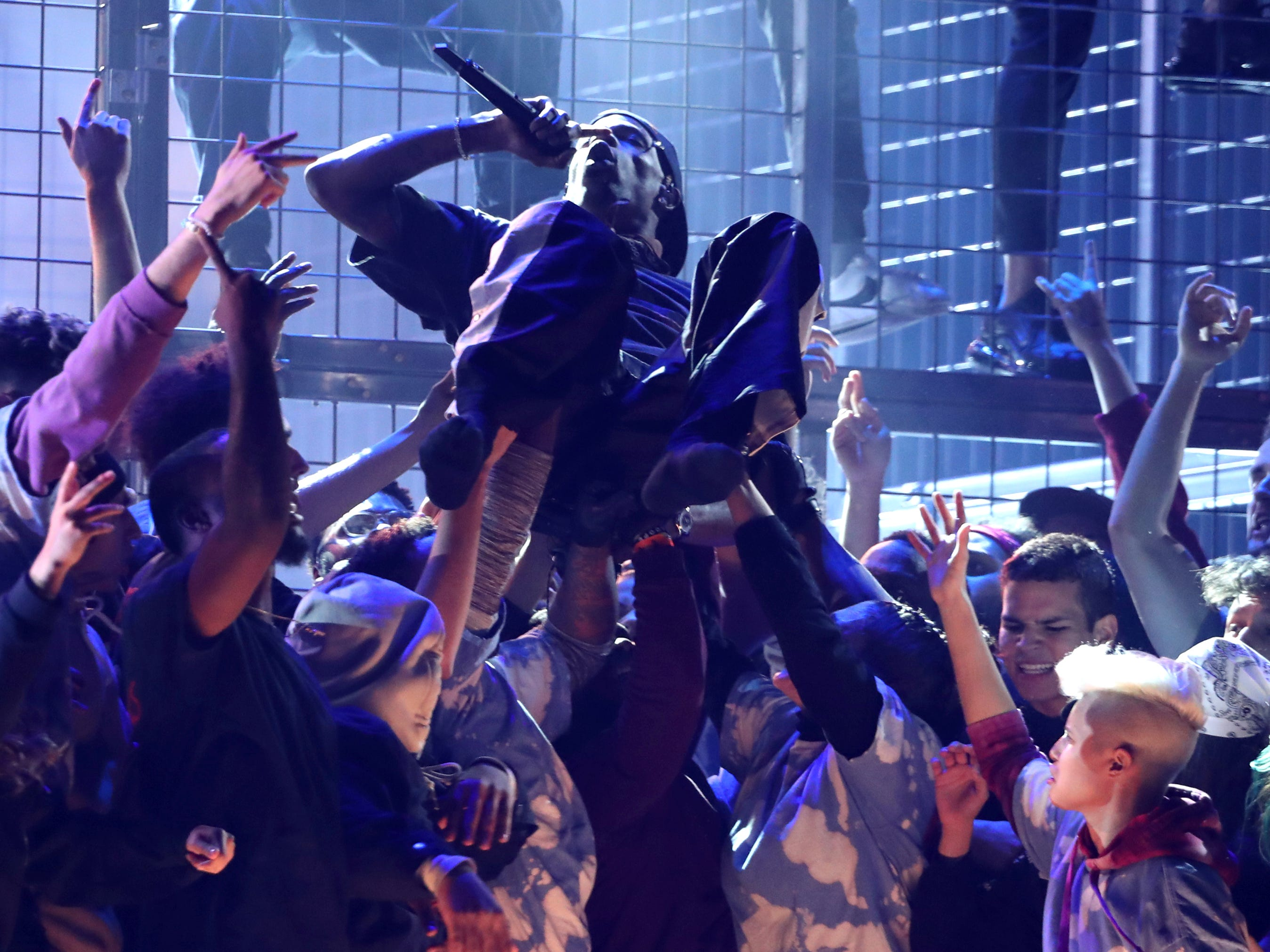 Travis Scott is carried during a performance at the 61st annual Grammy Awards on Sunday, Feb. 10, 2019, in Los Angeles.