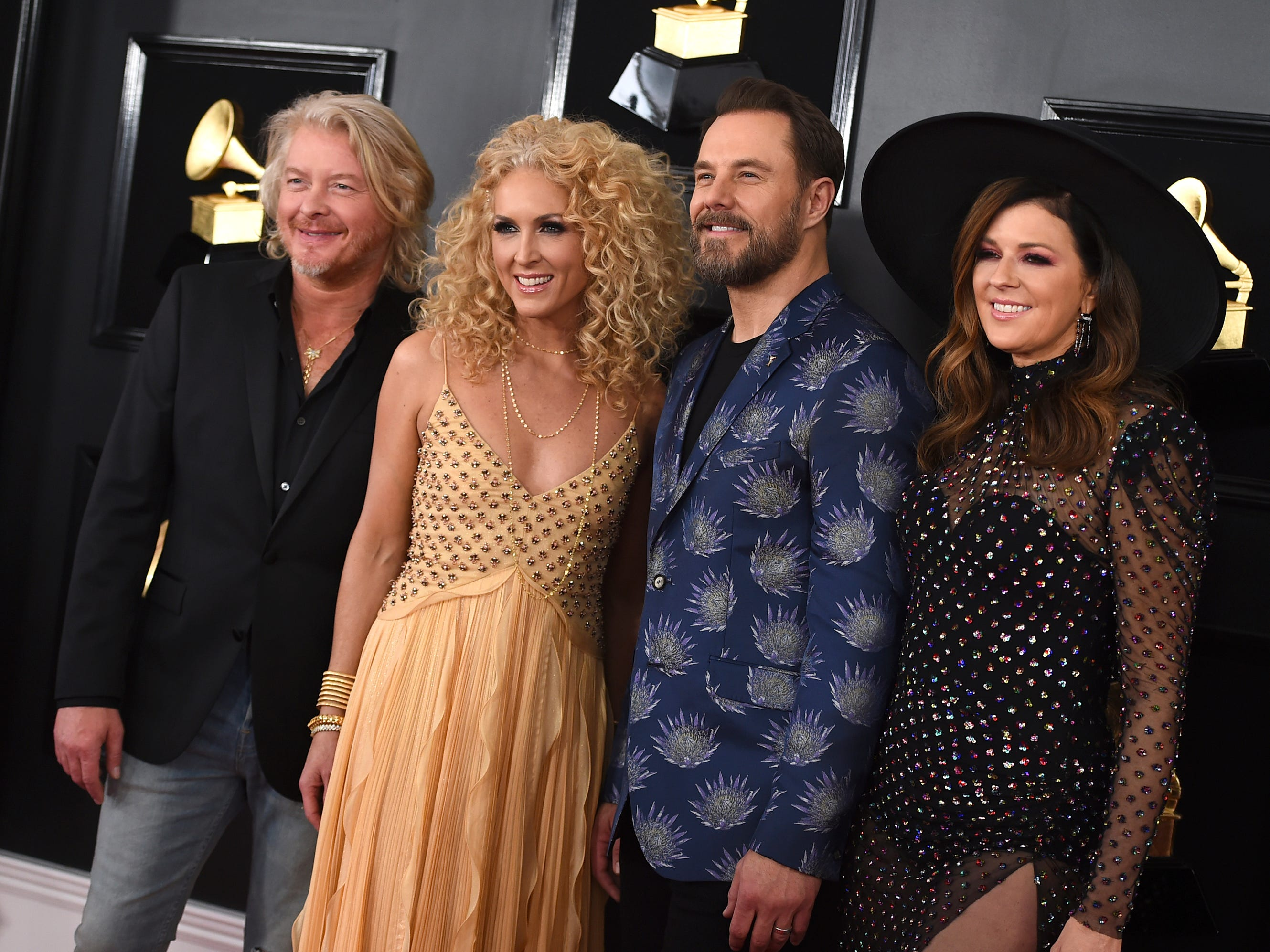 Philip Sweet, from left, Kimberly Schlapman, Jimi Westbrook, and Karen Fairchild of Little Big Town arrive at the 61st annual Grammy Awards at the Staples Center on Sunday, Feb. 10, 2019, in Los Angeles.