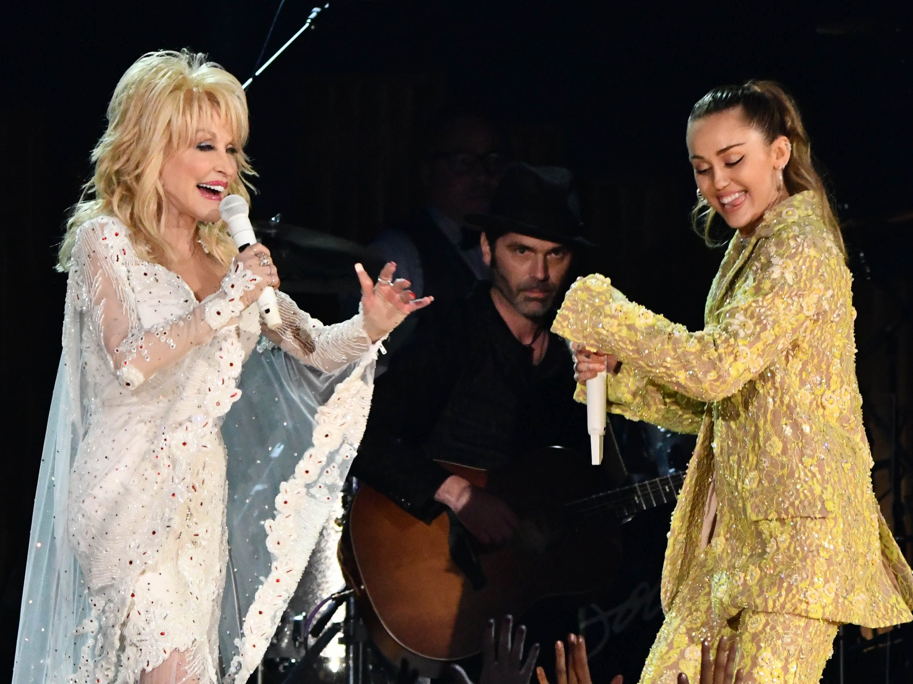 "Dolly Parton (L) and Miley Cyrus perform ""Jolene"" as part of a tribute to Dolly Parton during the 61st Annual GRAMMY Awards on Feb. 10, 2019 at STAPLES Center in Los Angeles, Calif."