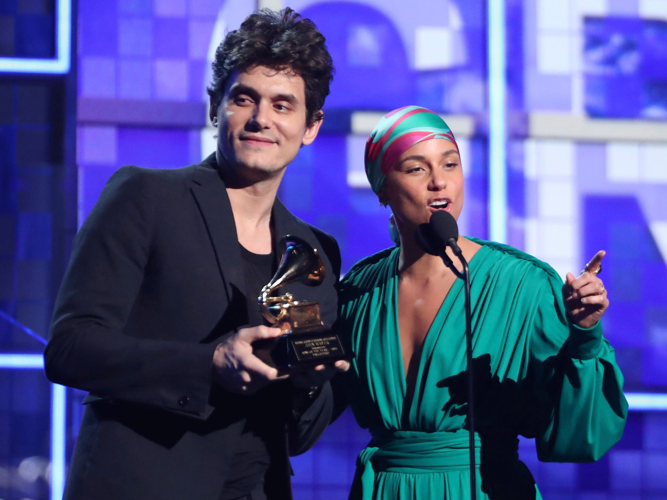 John Mayer, left, and Alicia Keys present the award for song of the year at the 61st annual Grammy Awards on Sunday, Feb. 10, 2019, in Los Angeles.
