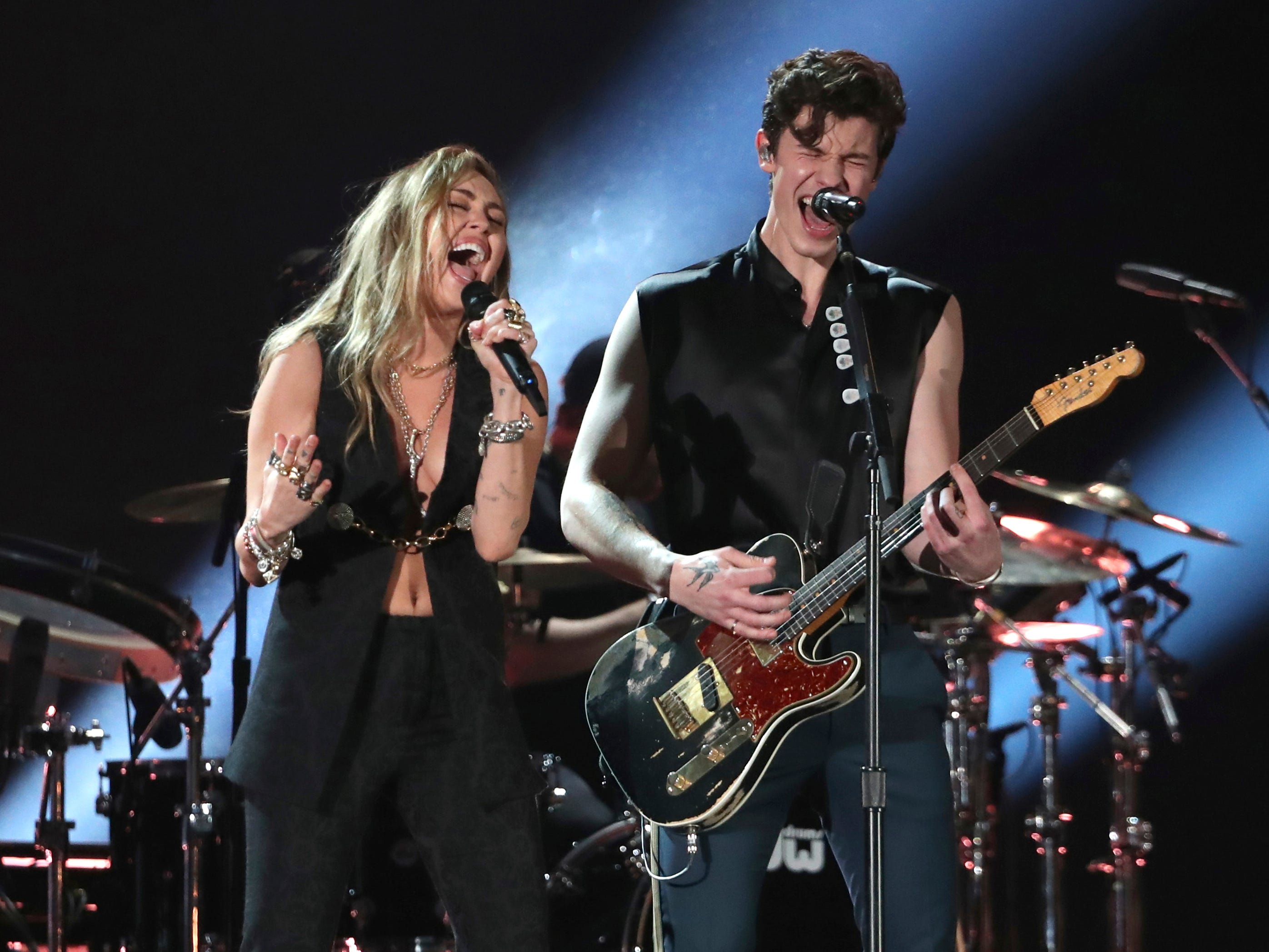 "Miley Cyrus, left, and Shawn Mendes perform ""In My Blood"" at the 61st annual Grammy Awards on Sunday, Feb. 10, 2019, in Los Angeles."