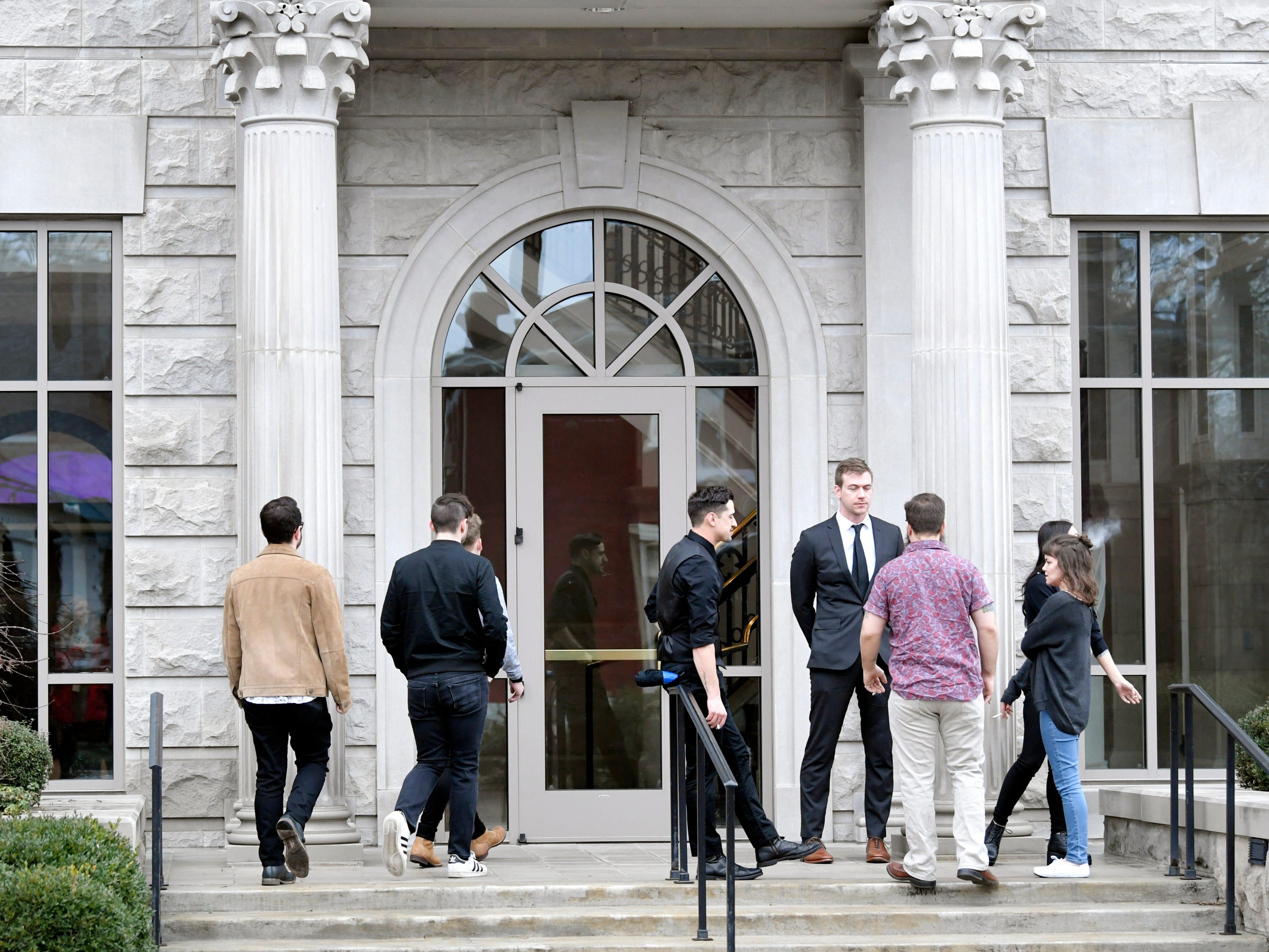 People walk in a side door of the Janet Ayers Academic Center, home to the Belmont University Chapel, where the memorial service for Kyle Yorlets was held Monday, Feb. 11, 2019. Police have charged five juveniles in the case. The memorial service followed a press conference by his fellow Carverton band members.