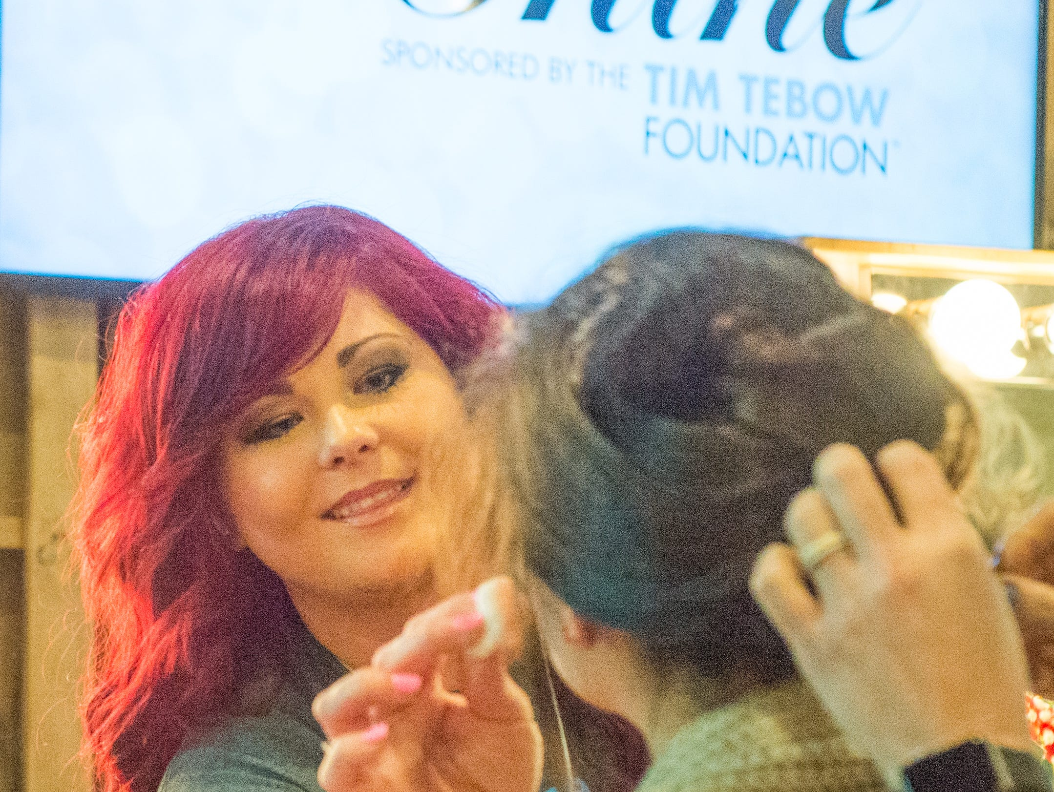 Tabitha Thompson helps style honored guests during the Night to Shine event held at NorthField Church in Gallatin on Friday, Feb, 8. The Night to Shine is a prom night experience presented by Tim Tebow Foundation to celebrate God's love for people with special needs.