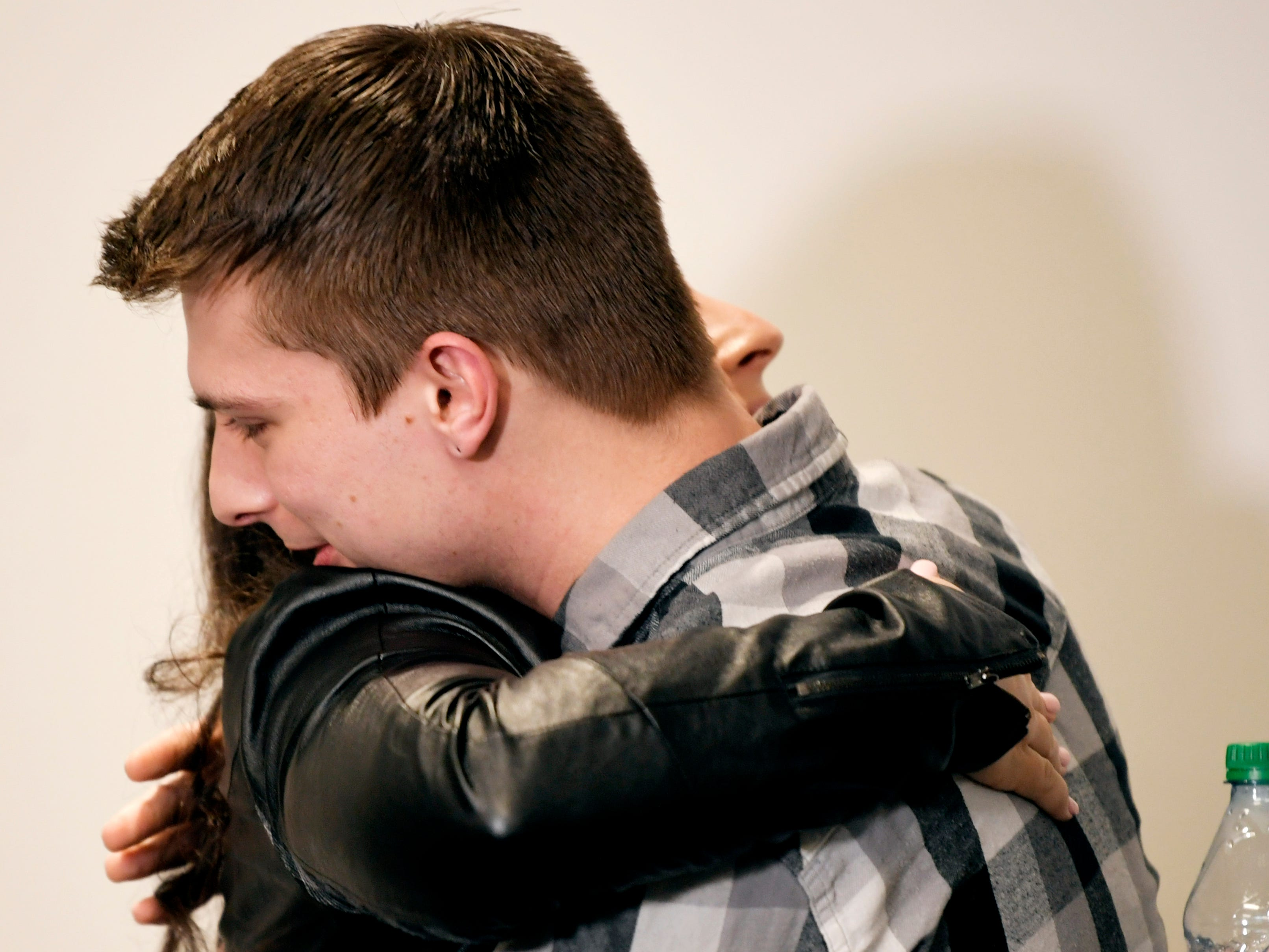 Carverton publicist Jen Appel hugs Michael Curry after a press conference about band member Kyle Yorlets at Belmont University on Monday, Feb. 11, 2019. Police have charged five juveniles in the case. A memorial service was scheduled to follow.