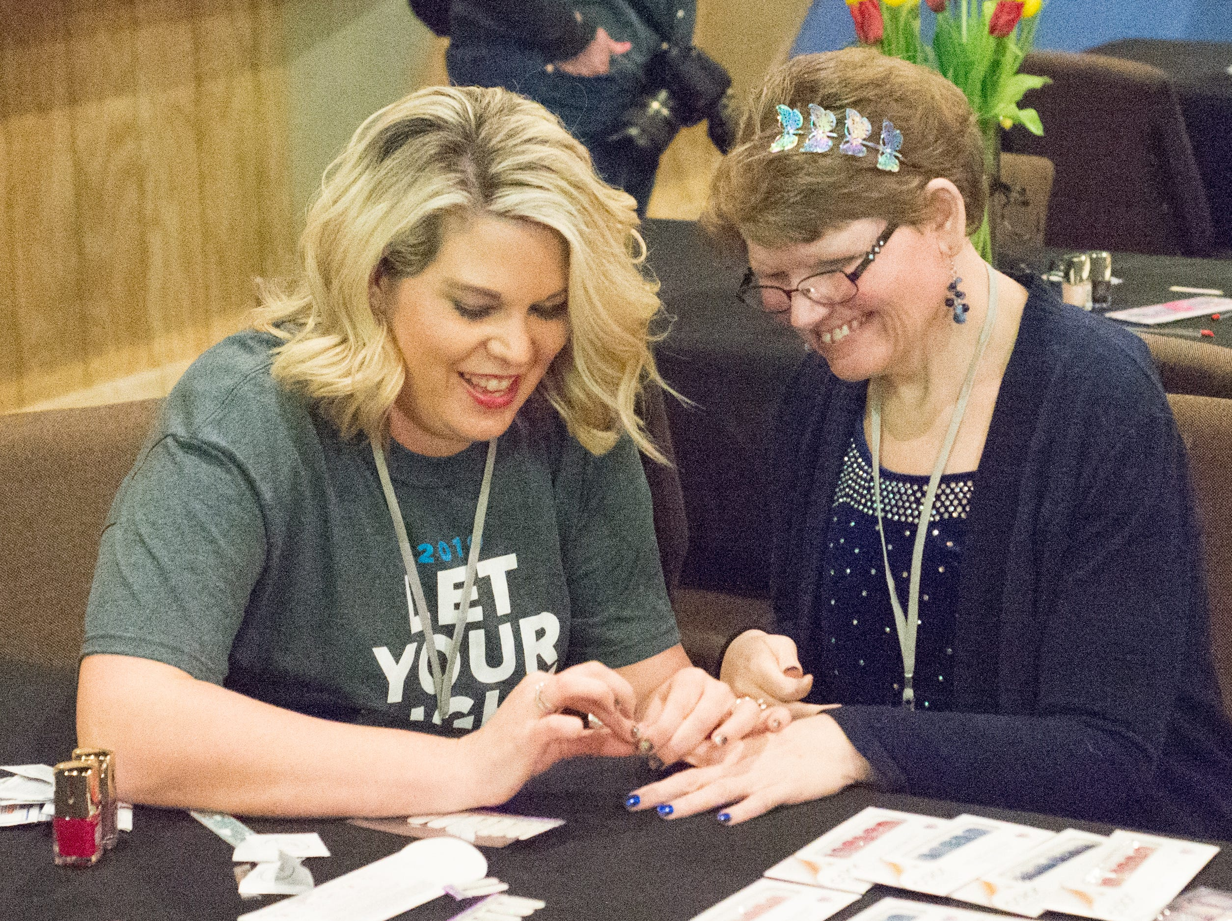 Ciji Gilley enjoys helping Jennifer Denson get ready for the Night to Shine event held at NorthField Church in Gallatin on Friday, Feb, 8.