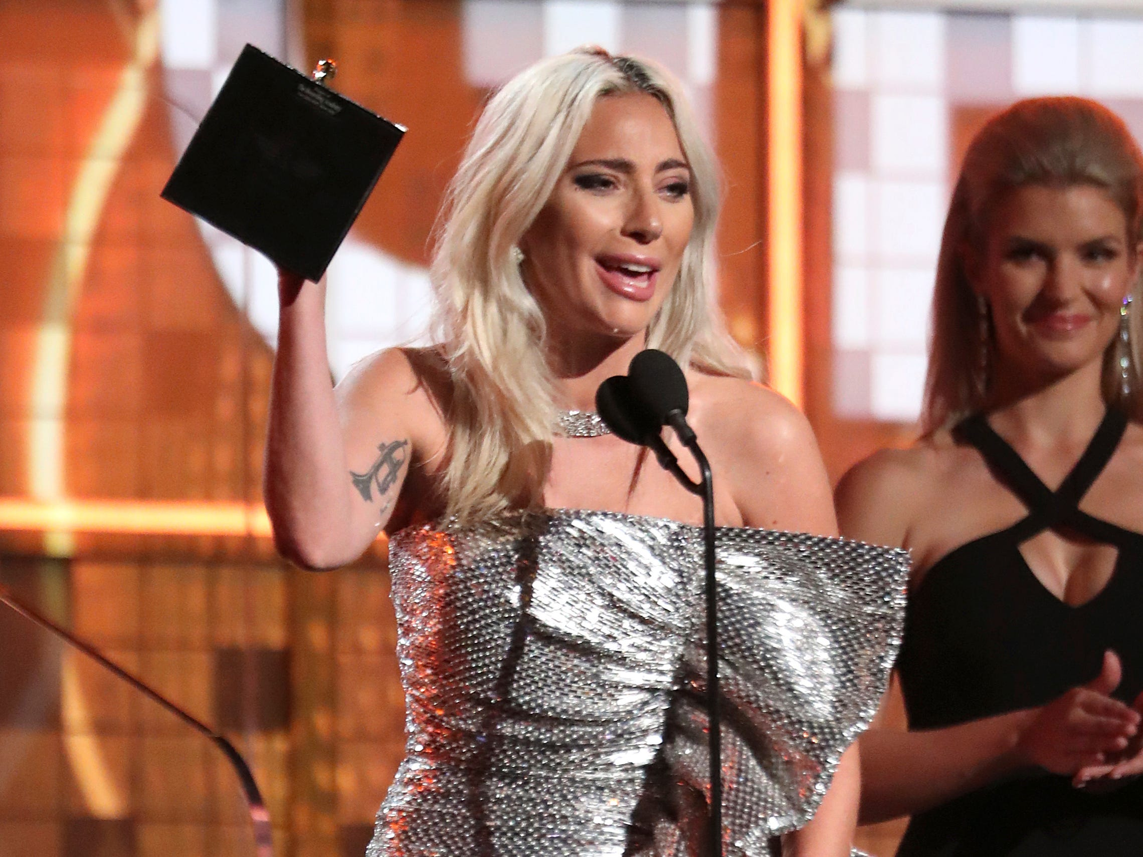 "Lady Gaga accept the award for best pop duo or group performance for ""Shallow"" at the 61st annual Grammy Awards on Sunday, Feb. 10, 2019, in Los Angeles."