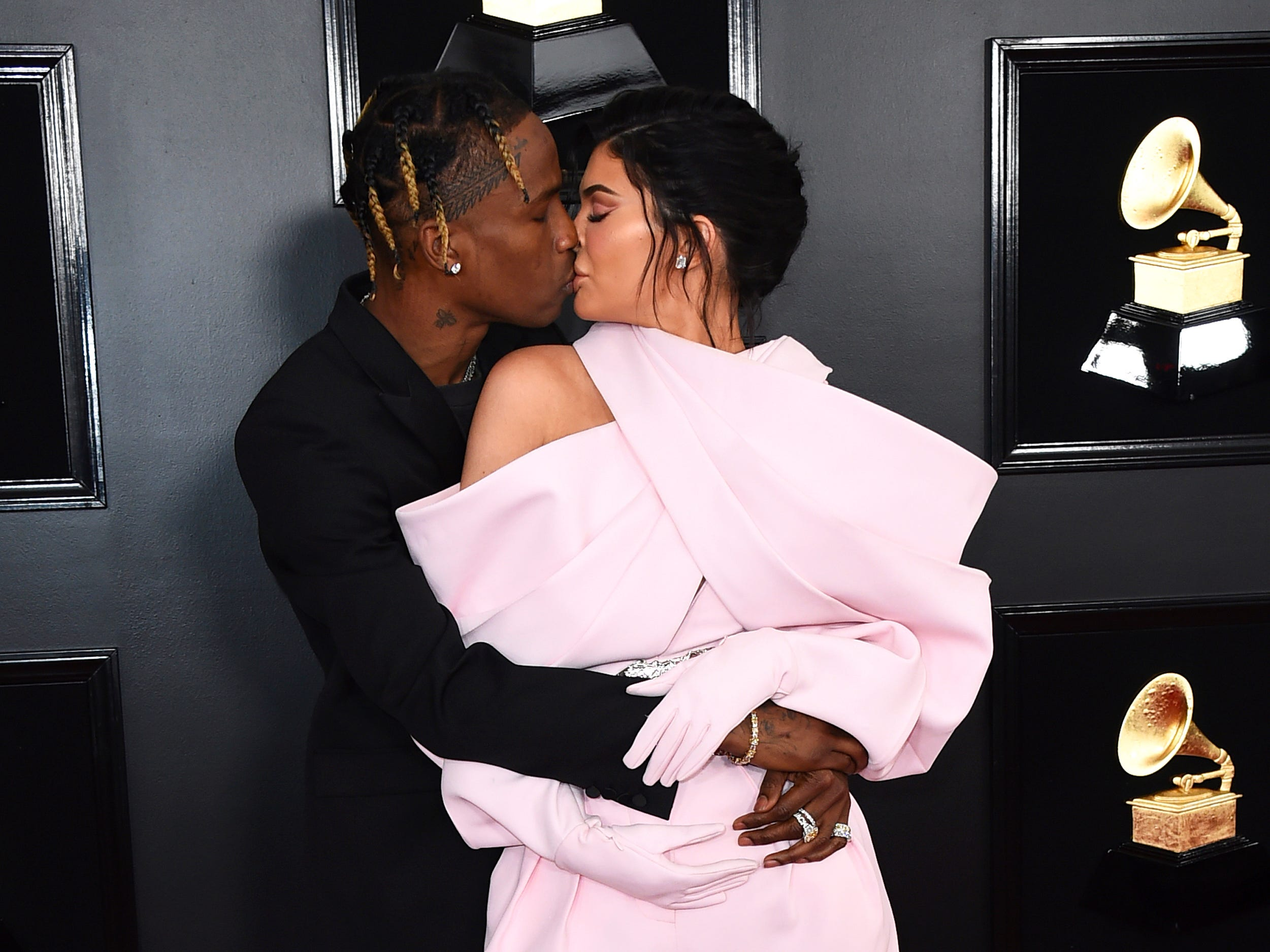Travis Scott, left, and Kylie Jenner arrive at the 61st annual Grammy Awards at the Staples Center on Sunday, Feb. 10, 2019, in Los Angeles.