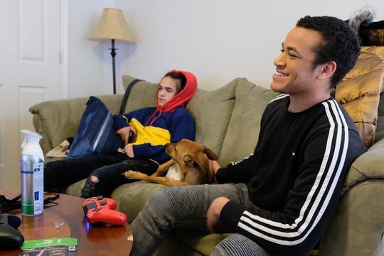 Zach Cruz hangs out with his dog Kobe and Sam Orlando, 15, in December. Orlando's parents, Mike Donovan and Richard Moore, have talked about adopting Zach.