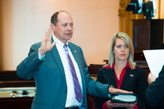 State Sen. Jay Hottinger, R-Newark, sworn in as senate majority whip for the 133rd General Assembly, with wife Cheri at his side.