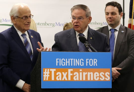 Senator Bob Menendez (behind podium) and Congressman Bill Pascrell Jr. (left) announce plans to introduce new legislation to repeal the federal cap from the Tax Cuts and Jobs Act of 2017.  The pair said the act currently taxes millions of people twice.  Monday, February 11, 2019