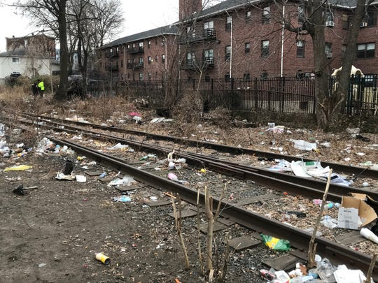 Portion of railroad tracks  in Passaic that are part of the New York & Greenwood Lake Railway, which runs into Garfield. Near here a person was found dead.