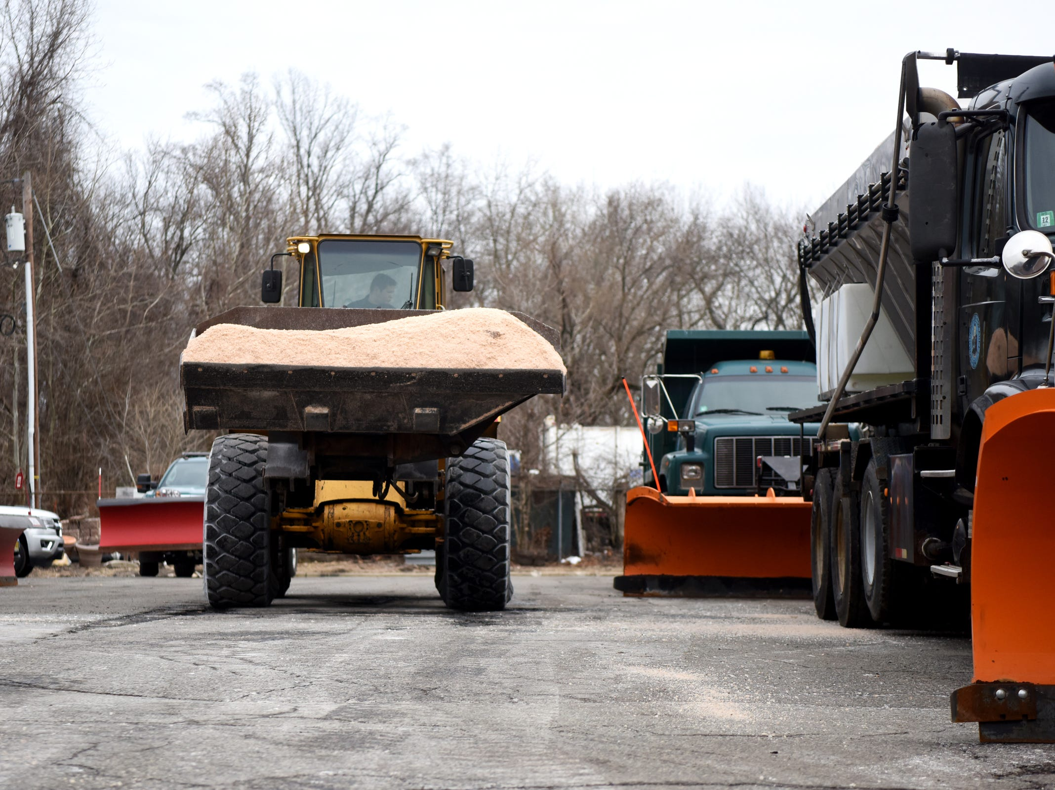 Borough of Oradell Department of Public Works employee Ross Rhein fills snow plows with salt on Monday, February 11, 2019 in preparation for a winter storm that could bring snow, ice and freezing rain on Tuesday.