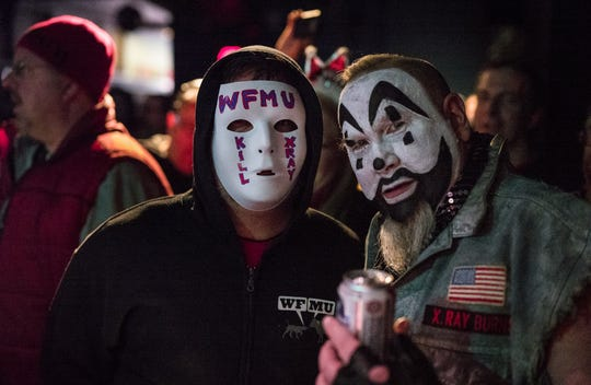 "Local radio personality, X.Ray Burns, and his co-host, Glen Jones, fostered an air of artifice similar to ""professional wrestling,"" Jones said after Burns death from cancer on Sunday, Feb. 10, 2019. The two hosted The Glen Burns Programme on WFMU in Jersey City. Burns, right, poses in clown make-up with a fan jokingly calling for the host's murder. Photo by Jeff Moore"