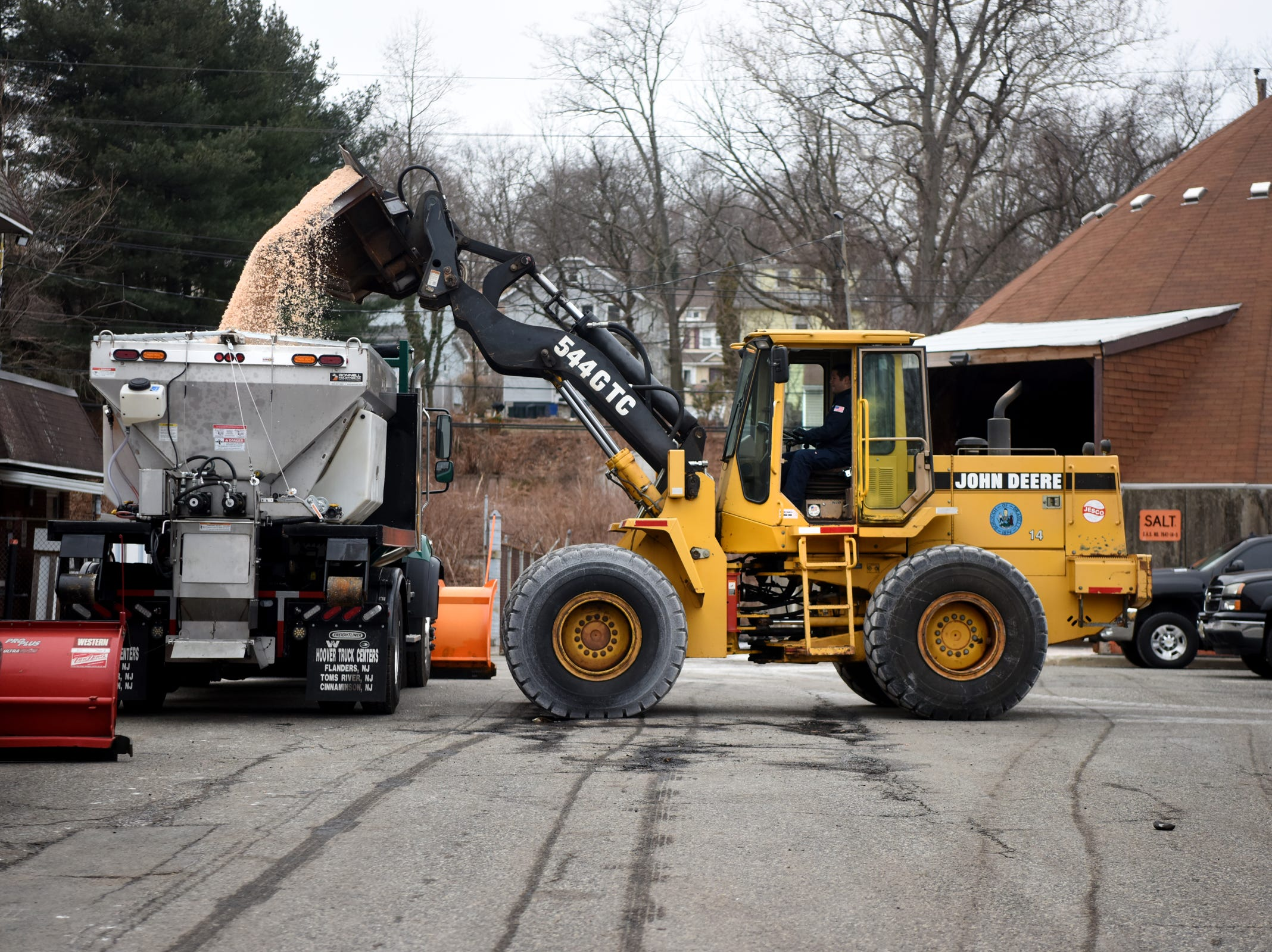 Borough of Oradell Department of Public Works employee Ross Rhein fills a snow plow with salt on Monday, February 11, 2019 in preparation for a winter storm that could bring snow, ice and freezing rain on Tuesday.