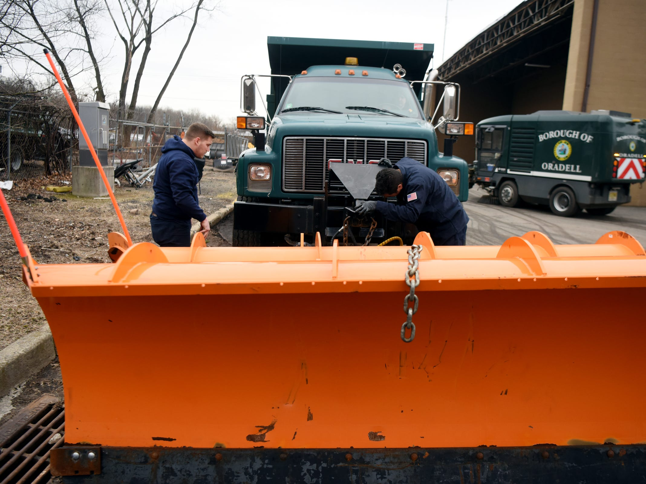 Borough of Oradell Department of Public Works employees Gordon Kohles and Ross Rhein attach a snow plow to a truck on Monday, February 11, 2019 in preparation for a winter storm that could bring snow, ice and freezing rain on Tuesday.