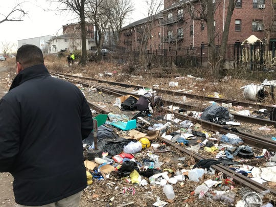 Mayor Hector Lora walks a portion of the abandoned New York and Greenwood Lake Railway, near Wall and 6th Streets. The city council has moved to purchase the tracks from developer Fadi Samaan.