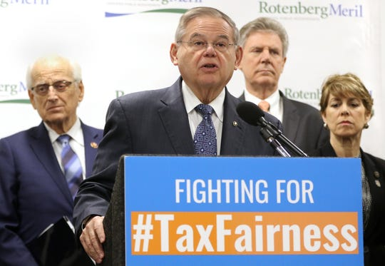 Senator Bob Menendez and Congressman Bill Pascrell Jr. (background) announce plans to introduce new legislation to reduce the amount of taxes residents have to pay.  Monday, February 11, 2019