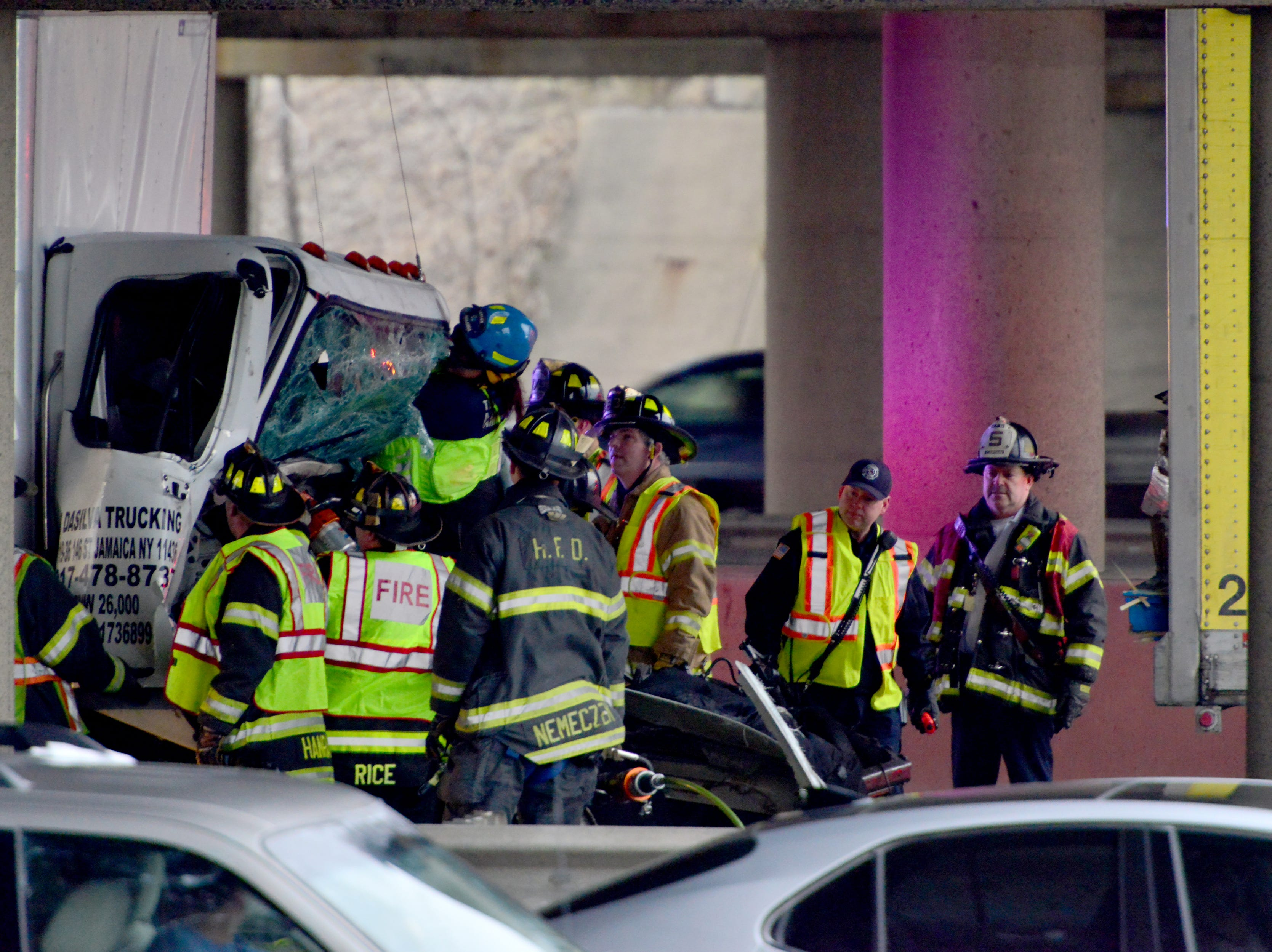 Emergency personel attempt to extricate a person from the cab of truck on I-95 northbound in Teaneck on Monday February 11, 2019. The accident between two truck under the Degraw Ave overpass has stopped all express lane traffic.