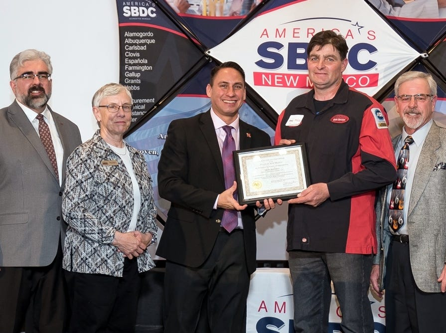 Local mechanic Mitchel Boomgaarn receives Star Client Award from Lt. Gov. Morales