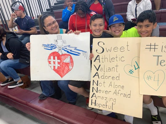 Students at a Zia Middle School basketball game over the weekend made signs in support of sixth-grader Savannah Tirre after she was punched on school grounds on Friday, Feb 8, 2019.