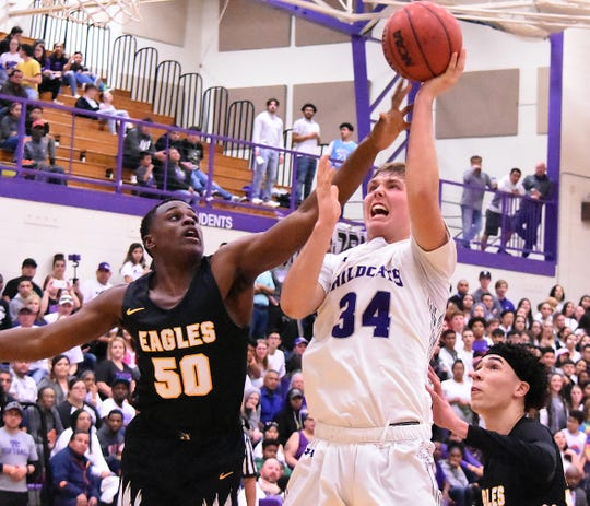 Clovis' Bryce Cabeldue gets a contested shot over Hobbs during their Feb. 1 game. Cabeldue has 32 points, 25 rebounds and six assists for the Wildcats in their first three district games.