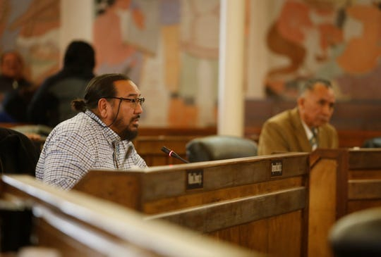 Delegate Raymond Smith Jr., left, talks about a bill to assign delegates to standing committees during a Navajo Nation Council special session on Monday in Window Rock, Ariz.