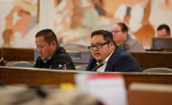 Navajo Nation Council Speaker Seth Damon, right, responds to a question on Monday about his assignment of delegates to serve on the council's standing committees.