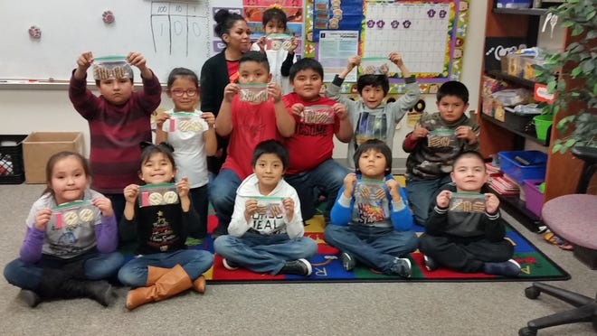 Room Mother, Mrs. Francis Kinzhuma, created the number 100 using cookies for the students to snack on. The students enjoyed numerous activities commemorating 100 Days of school.