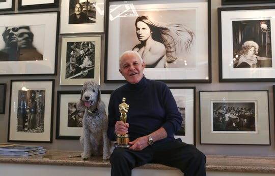 "Michael Childers holds the Oscar won by his partner John Schlesinger who directed ""Midnight Cowboy.""  Childers was a still photographer on the set of the film."