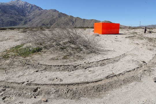"Tire tracks cross the open desert near the Desert X art installation ""Specter"" near Snow Creek Road and Hwy 111 in Palm Springs, February 11, 2019."