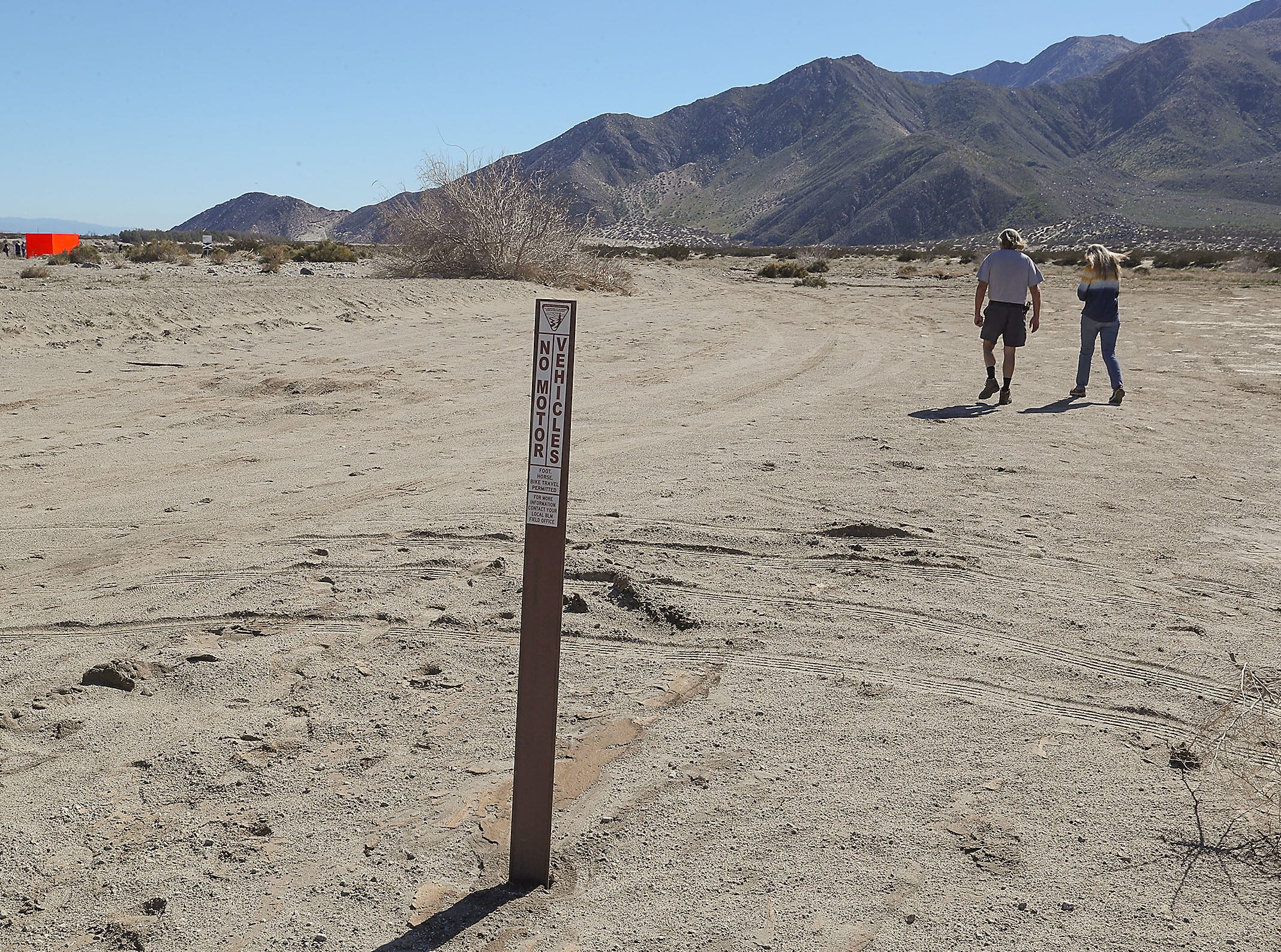 "A Bureau of Land Management sign tells people not to drive past this point near the Desert X art installation ""Specter"" near Snow Creek Road and Hwy 111 in Palm Springs, February 11, 2019."