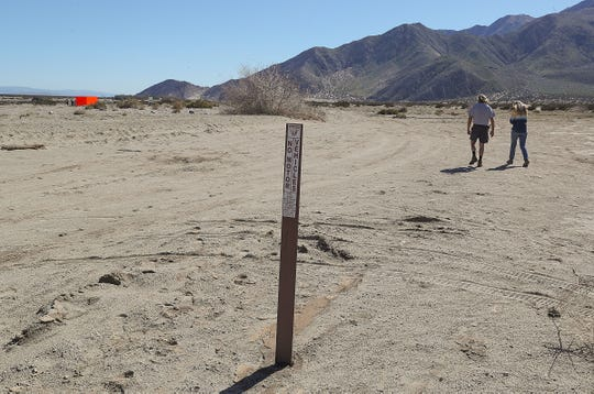 """A Bureau of Land Management sign tells people not to drive past this point near the Desert X art installation """"Specter"""" near Snow Creek Road and Hwy 111 in Palm Springs, February 11, 2019."""