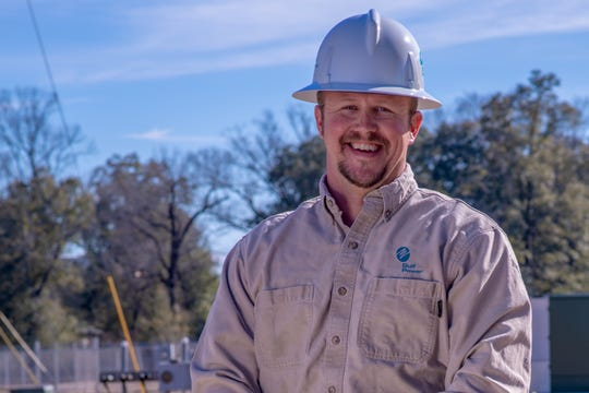 Jeremy Davey, a service technician with Gulf Power's Pine Forest office, found a bank envelope full of cash in the middle of the road last month and worked to track down its rightful owner.
