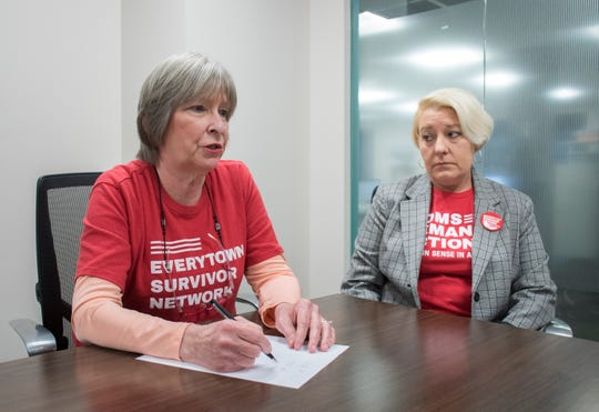 "At left, Betsy Dale Adams, a survivor fellow in the Everytown Survivor Network, and Gay Valimont, a volunteer Florida chapter leader of Moms Demand Action, talk Monday about ""gunsense"" reform efforts. The Gulf Breeze women were among more than 500 advocates from Moms Demand Action and Everytown for Gun Safety who traveled to Tallahassee last week to advocate a bill that would require background checks on all gun sales, and against a bill that would allow teachers to carry firearms in the classroom."