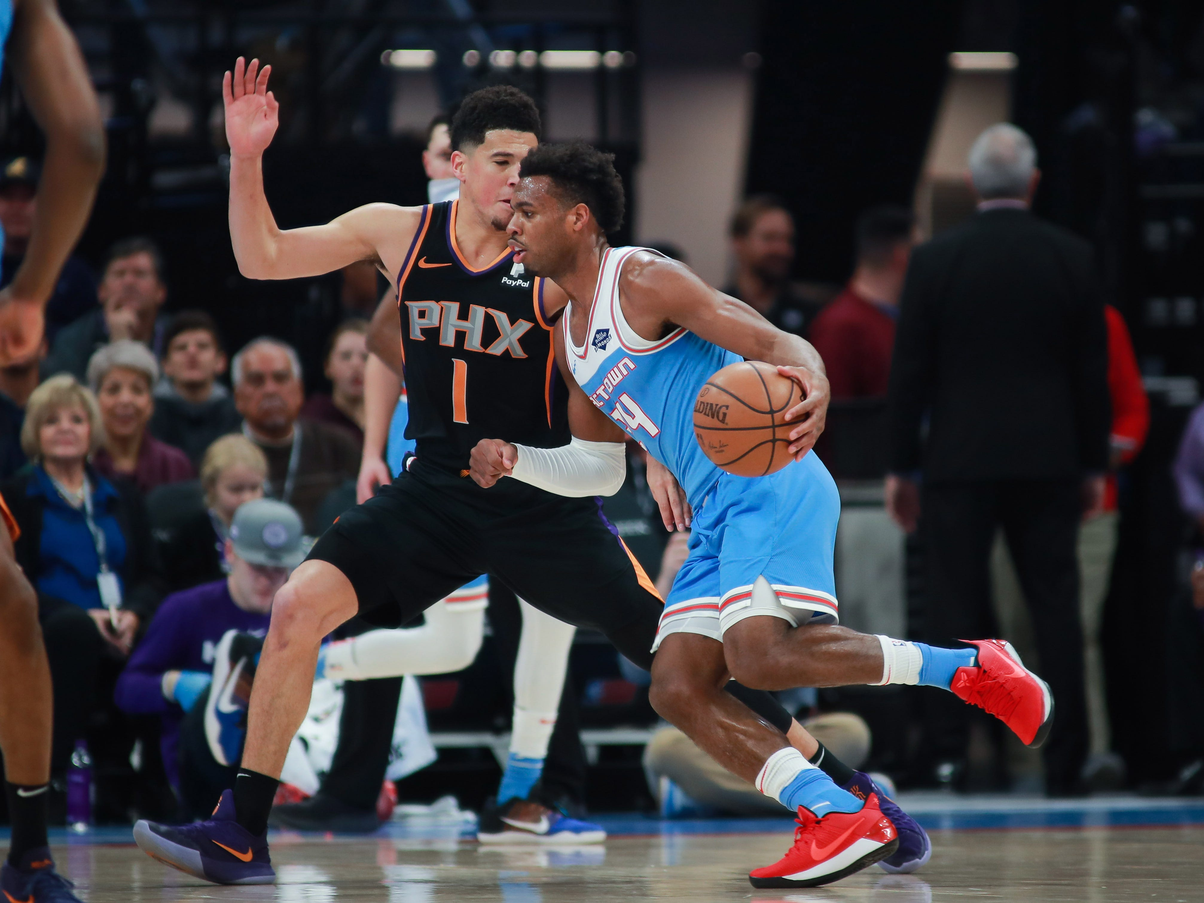 Feb 10, 2019; Sacramento, CA, USA; Sacramento Kings guard Buddy Hield (24) dribbles the ball around Phoenix Suns guard Devin Booker (1) during the first quarter at Golden 1 Center.