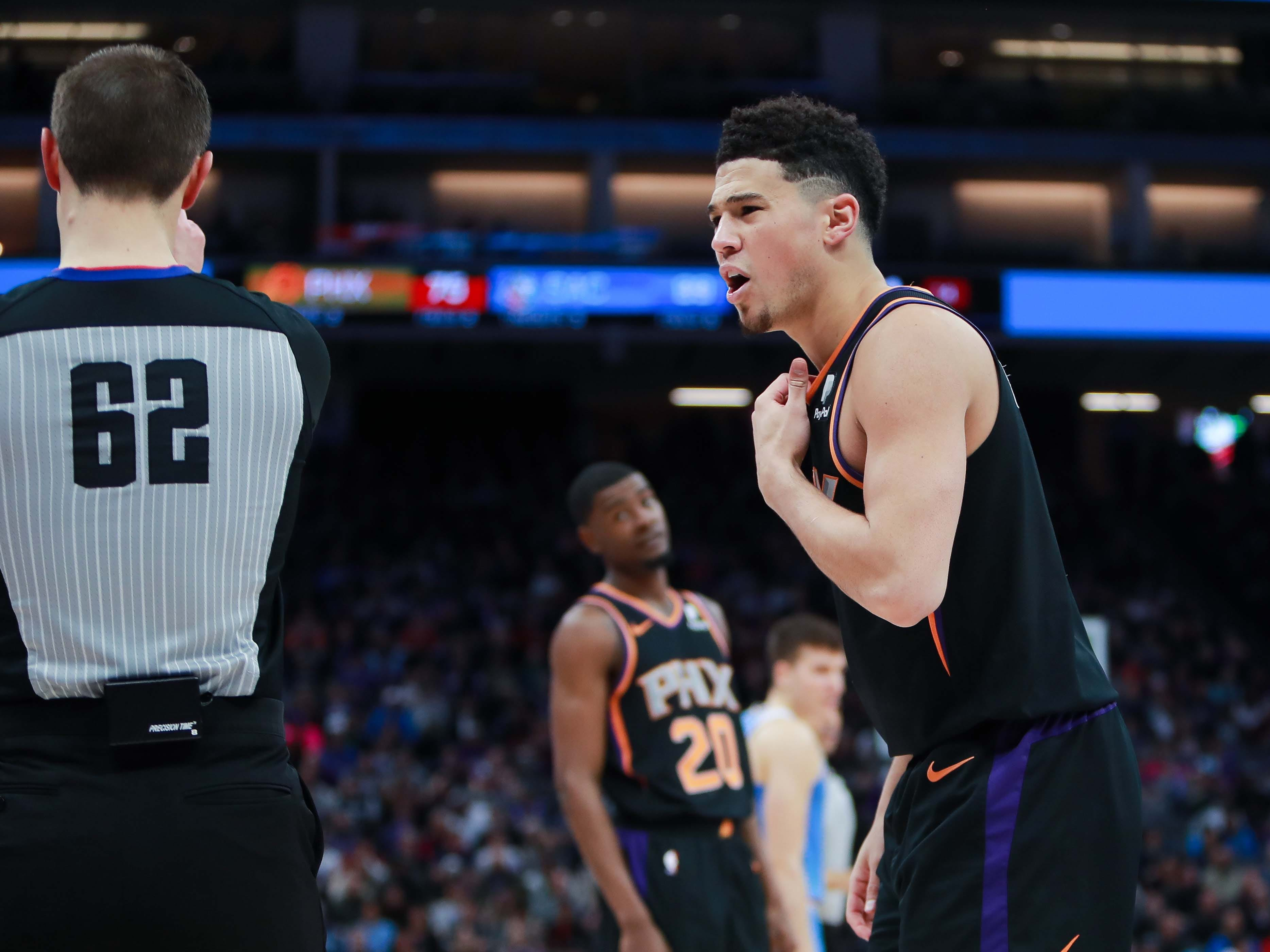 Feb 10, 2019; Sacramento, CA, USA; Phoenix Suns guard Devin Booker (1) argues a call with referee JB DeRosa (62) during the fourth quarter against the Sacramento Kings at Golden 1 Center.