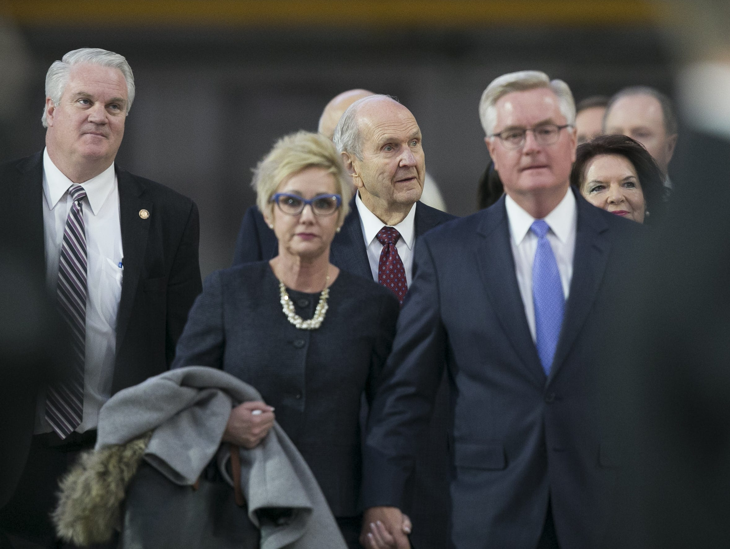 Russell Nelson (center), the president of the Church of Jesus Christ of Latter-day Saints arrives at State Farm Stadium before speaking at a devotional in Glendale, Arizona on Sunday, Feb. 10, 2019.