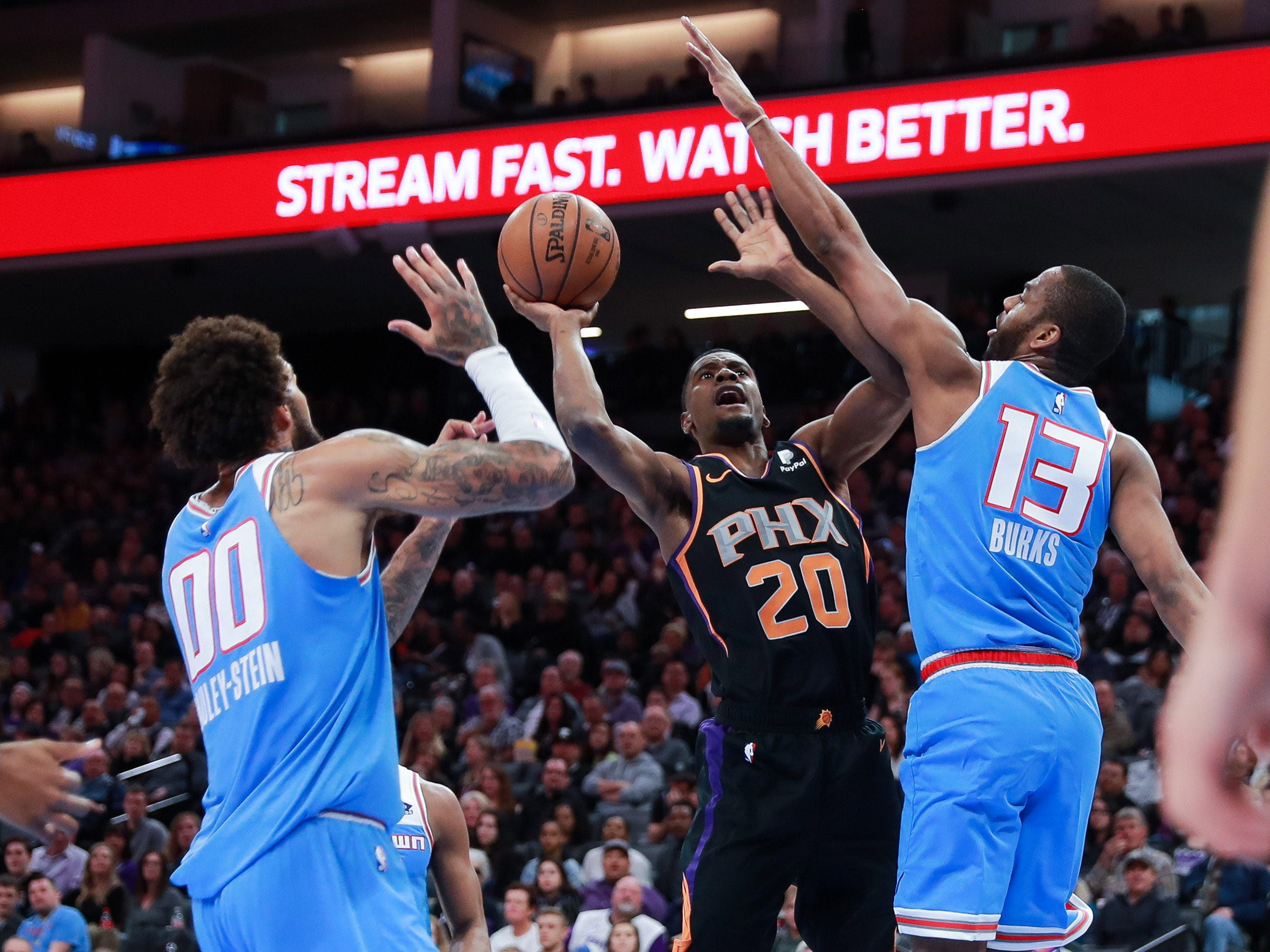 Feb 10, 2019; Sacramento, CA, USA; Phoenix Suns forward Josh Jackson (20) shoots the ball against Sacramento Kings guard Alec Burks (13) and center Willie Cauley-Stein (00) during the second quarter at Golden 1 Center.