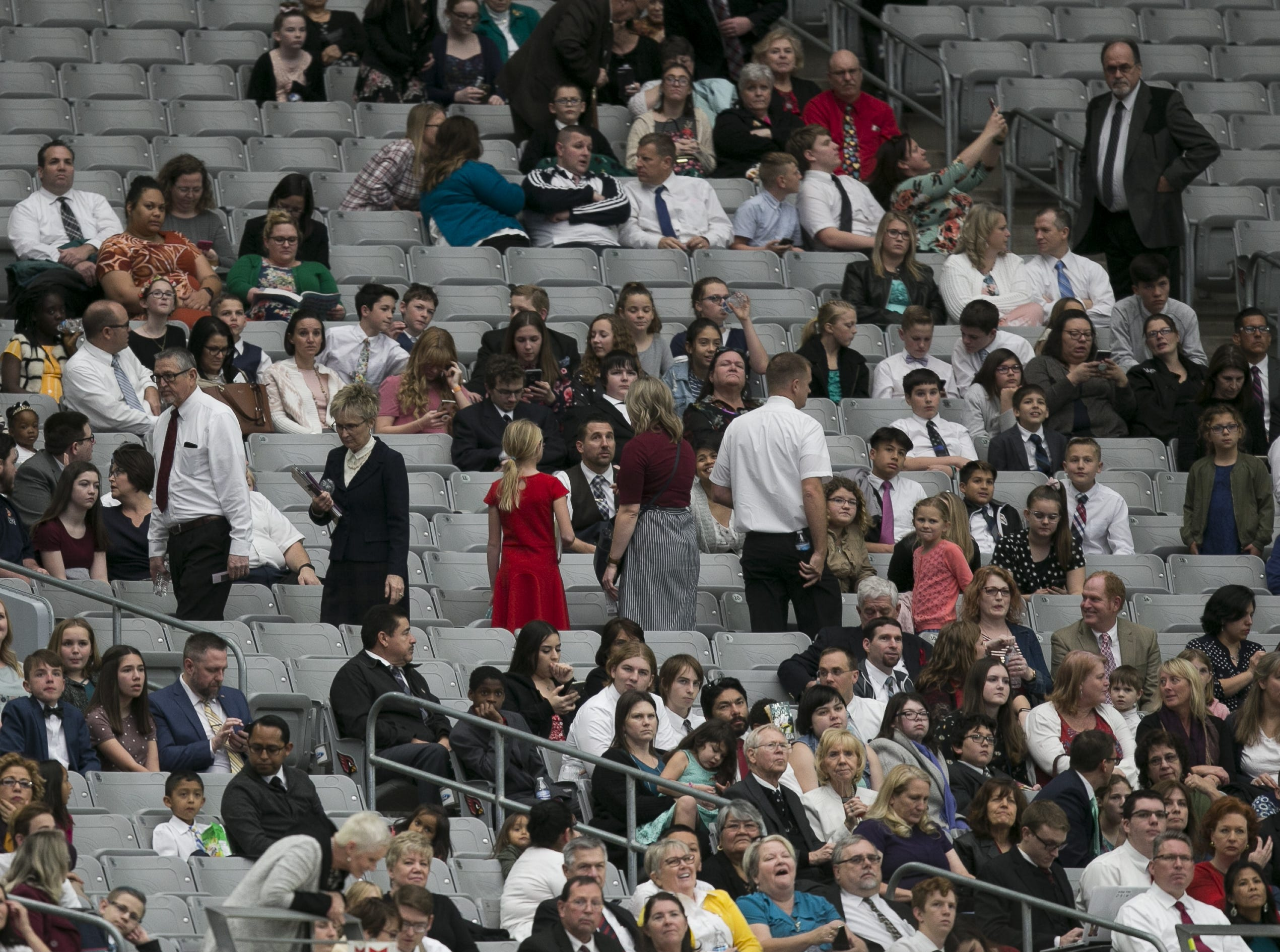 Members of the Church of Jesus Christ of Latter-day Saints wait at State Farm Stadium to hear church President Russell Nelson speak for a devotional in Glendale, Arizona on Sunday, Feb. 10, 2019.