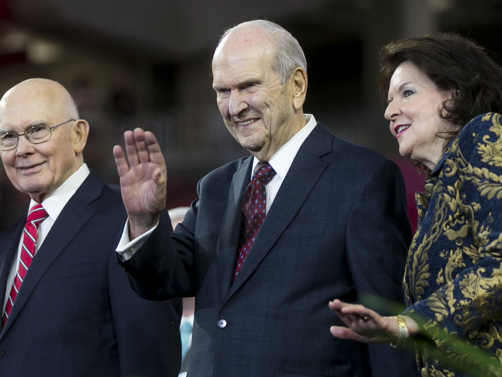 Russell Nelson, the president of the Church of Jesus Christ of Latter-day Saints waves at members of the church at State Farm Stadium before speaking for a devotional in Glendale, Arizona on Sunday, Feb. 10, 2019.