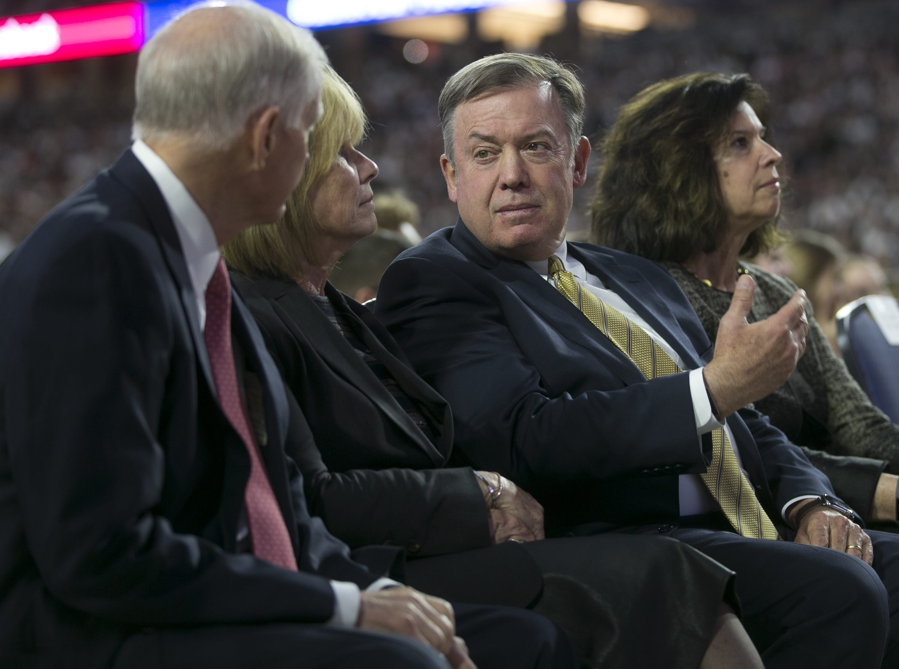Arizona State University president Michael Crow (center-right) and his wife Sybil Francis (far-right) wait with members of the the Church of Jesus Christ of Latter-day Saints to hear President Russell Nelson speak at a devotional at State Farm Stadium in Glendale, Arizona on Feb. 10, 2019.