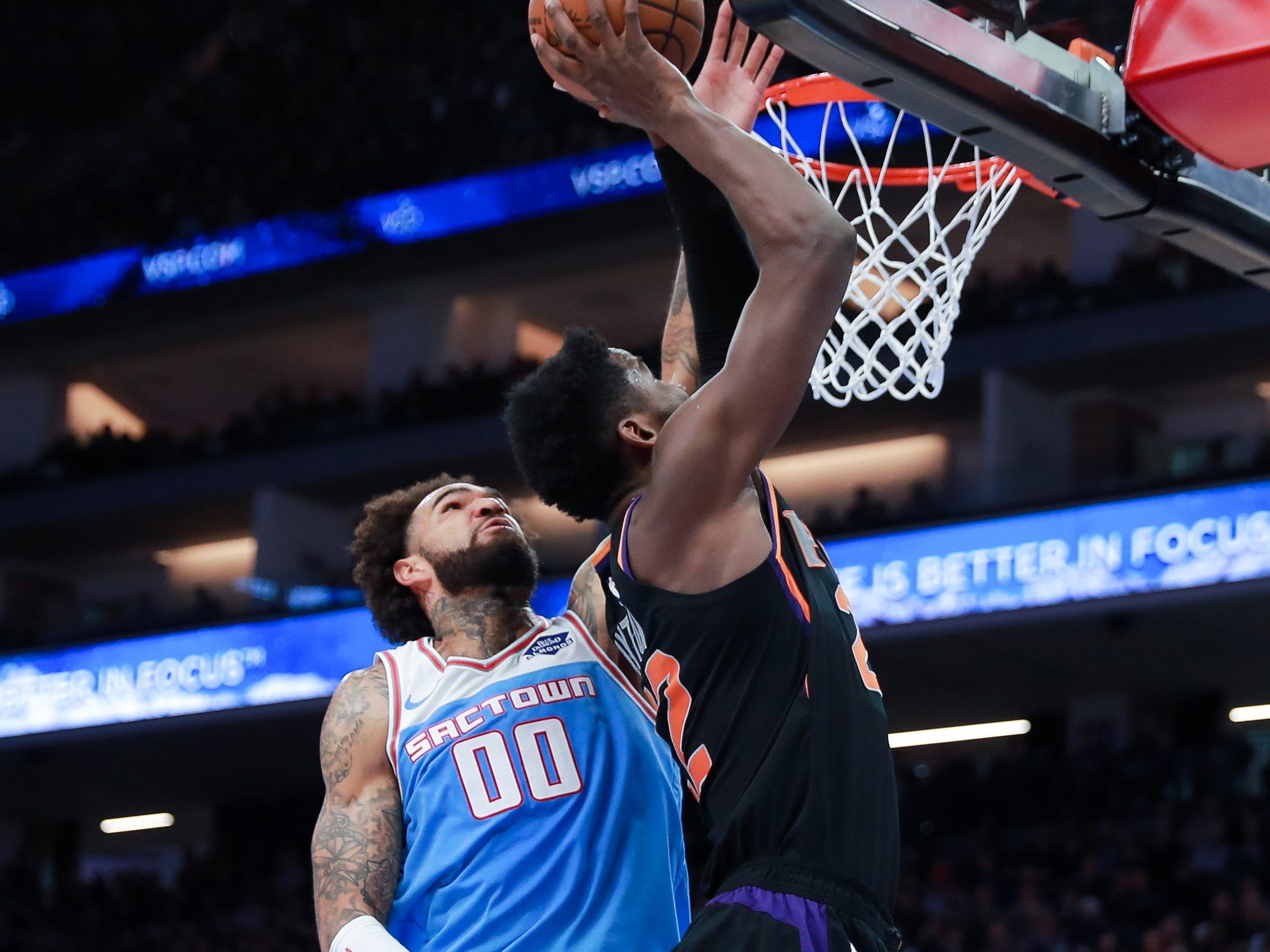 Feb 10, 2019; Sacramento, CA, USA; Sacramento Kings center Willie Cauley-Stein (00) blocks a shot by Phoenix Suns center Deandre Ayton (22) during the second quarter at Golden 1 Center.