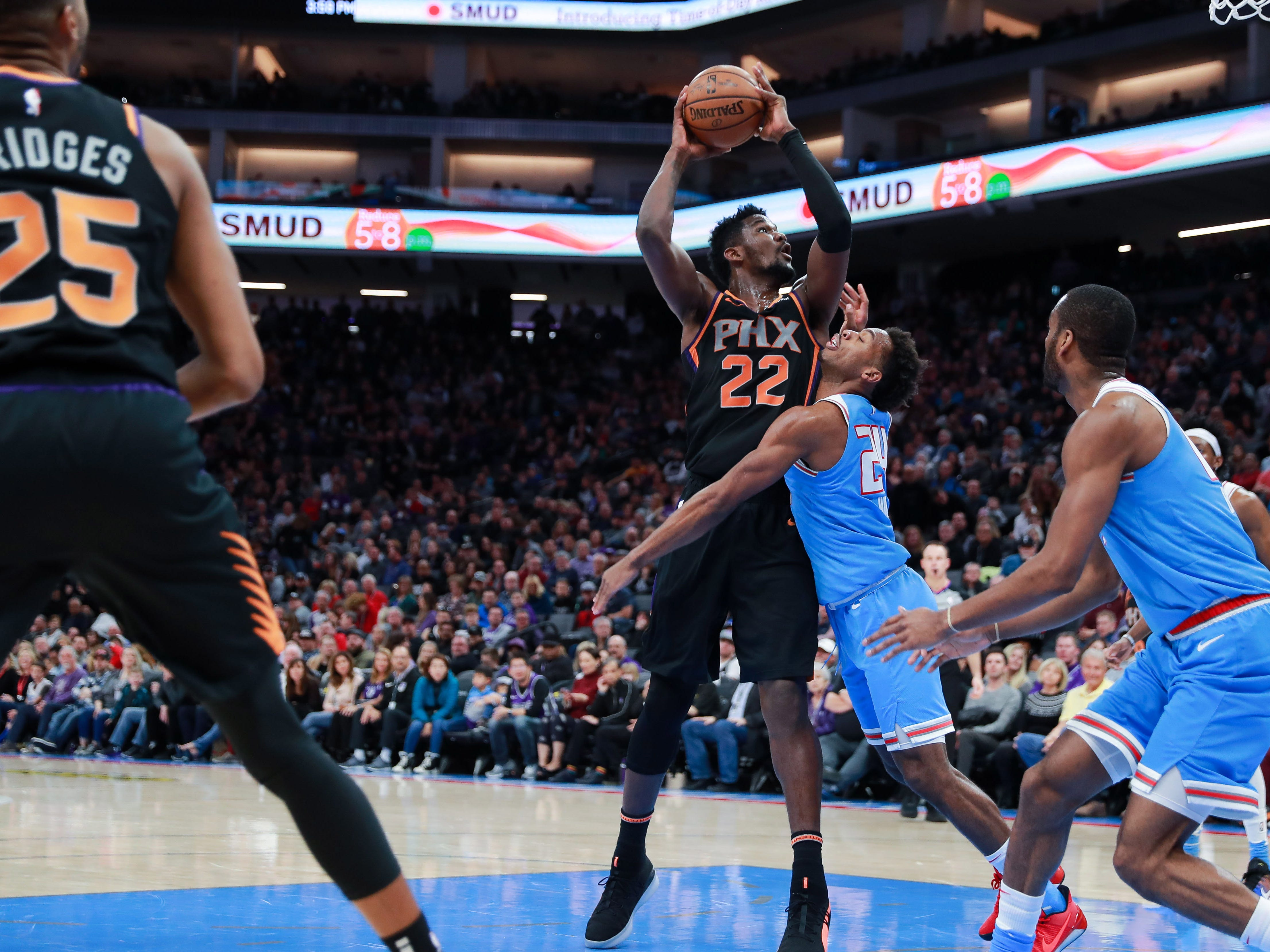 Feb 10, 2019; Sacramento, CA, USA; Phoenix Suns center Deandre Ayton (22) shoots the ball over Sacramento Kings guard Buddy Hield (24) during the second quarter at Golden 1 Center.