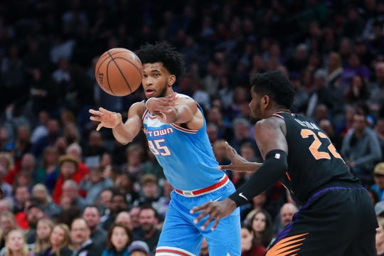 Feb 10, 2019; Sacramento, CA, USA; Sacramento Kings forward Marvin Bagley III (35) passes the ball against Phoenix Suns center Deandre Ayton (22) during the fourth quarter at Golden 1 Center.