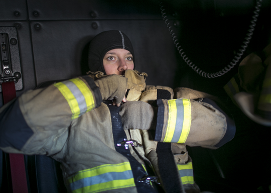 Firefighter Leigh Graziano suits up on a call with Glendale Fire Department Station 154 on Feb. 7, 2019, in Glendale.